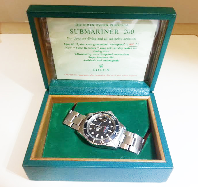 This Red Submariner is in excellent condition and has almost all of the authentication documentation.