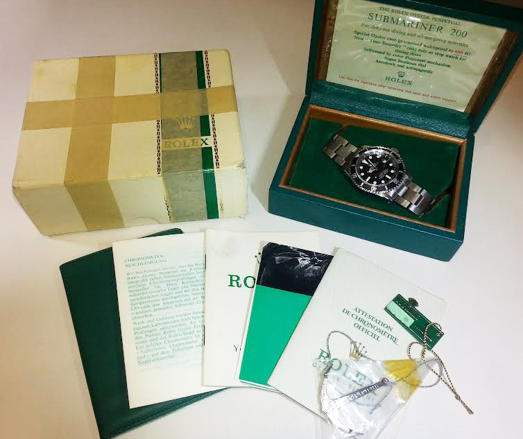 Rolex Red Submariner documentation of authenticity.