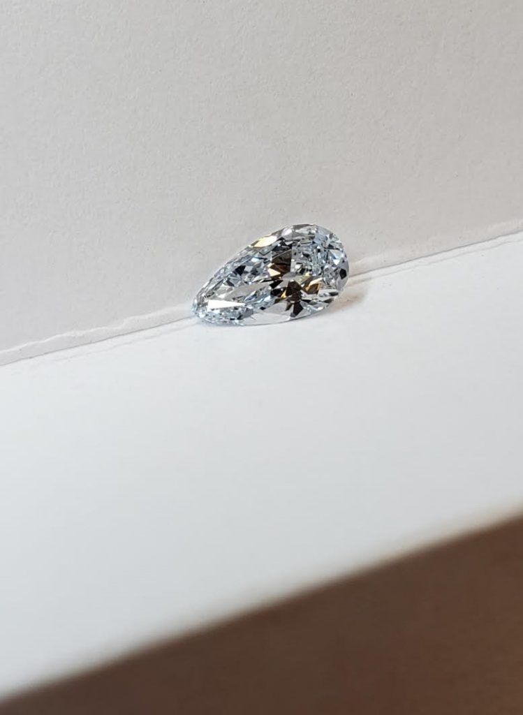 This fancy light blue diamond was cut into the shape of a pear to intensify the blue saturation.