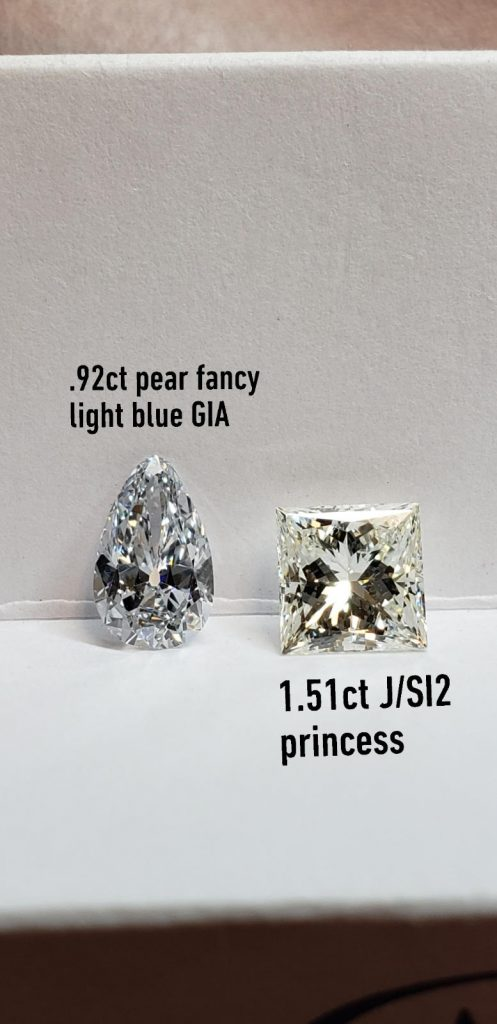 """The """"J"""" color diamond would typically appear white to the naked eye but next to this fancy light blue diamond, the near-colorless diamond appears very yellow."""