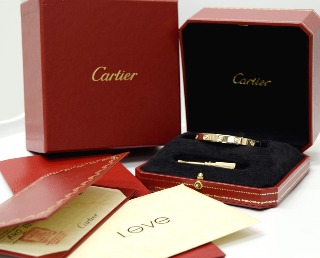 Cartier Love Bracelets famously come with a screw driver to get the bracelet off and on